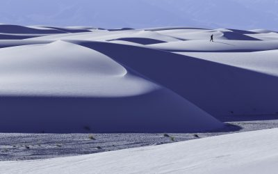A hiker in White Sands National Monument, New Mexico.