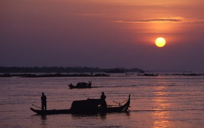Early morning scene in Cambodia. Fishing boats go out for the morning catch. Image from slide, professionally scanned.