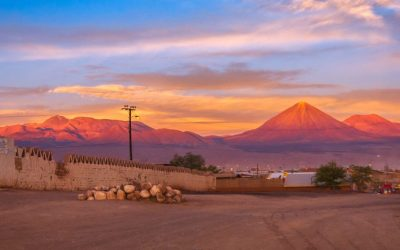 Andes and the desert with Licancabur volcano on the Bolivian border in the sunset at full moon, San Pedro de Atacama, Chile, South America