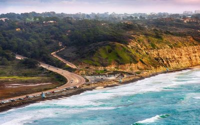 Highway 101 along the southern California coastline as it reaches the cliffs of the famous Torrey Pines reserve in the La Jolla area of the City of San Diego.  This image was shot at an altitude of approximately 1000 feet over the Pacific Ocean during a helicopter photo flight.
