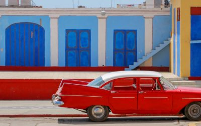 Old red car parked on the street in Trinidad, Cuba.