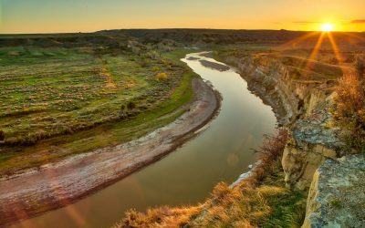 Sunset at Theodore Roosevelt National Park. Look closely for the Bison along the river bank.