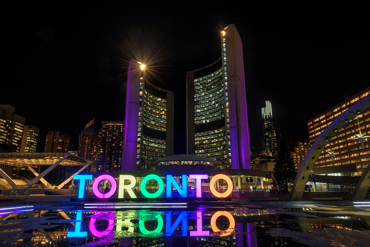 View of Toronto Sign on Nathan Phillips Square at night, Canada.